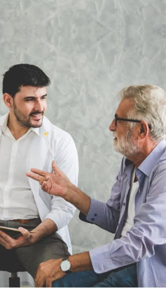 therapist talking to an elder man