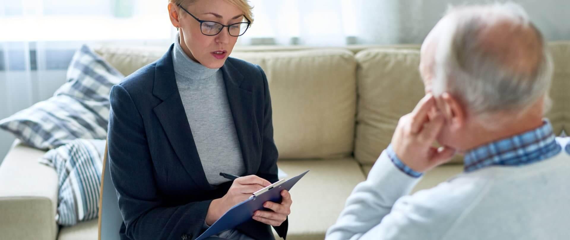 elder man talking to a therapist