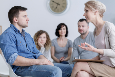 adult man having session with counselor